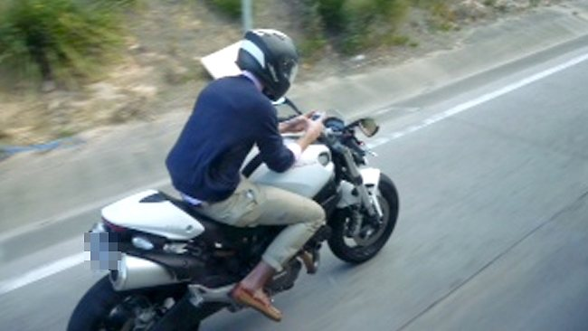 motorcycle-rider-texting
